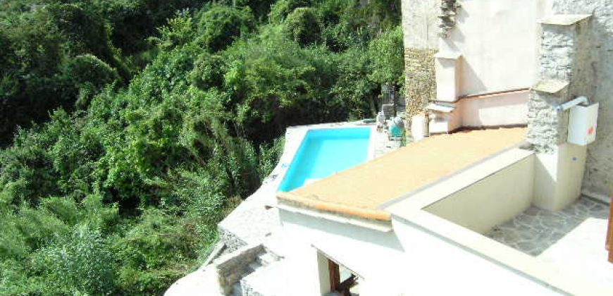 For sale a lovely restored apartment with large terrace and a common pool
